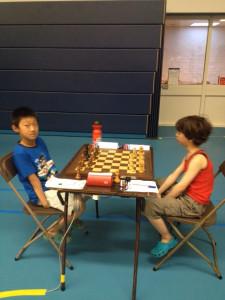 Rufus Ang met wit tegen Yichen Han